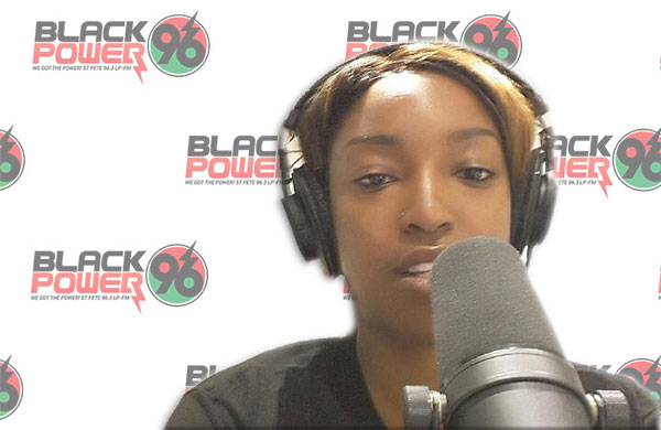 Tonya, Black Power 96 Radio''s Supporting Membership Program Manager, tests out the new host microphone.